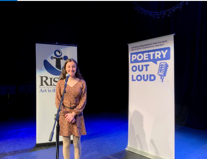 High Student in a dress performing poetry